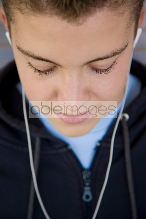 Close up of a boy wearing earphones
