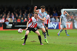 Sam Jones of Grimsby Town applies pressure on Carl Winchester of Cheltenham Town  - Mandatory by-line: Nizaam Jones/JMP - 17/04/2017 - FOOTBALL - LCI Rail Stadium - Cheltenham, England - Cheltenham Town v Grimsby Town - Sky Bet League Two