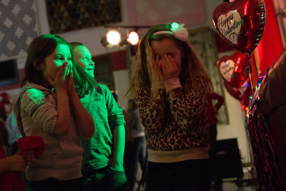 Children laugh in embarrassment on the dance floor during the Valentine's Day Dinner Dance held at the Community Center in Shade, Ohio on Feb. 17, 2013.