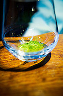 Matcha, green tea powder, in a glas at the Ishinohana Bar Shibuya,Tokyo, Japan