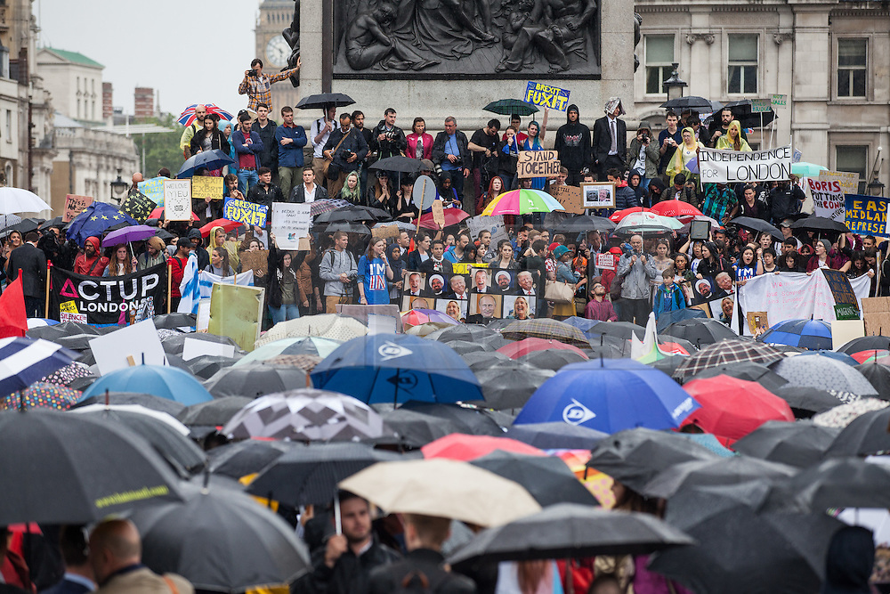 © Licensed to London News Pictures. 28/06/2016. London, UK. Thousands protest in Trafalgar Square against the result of the EU referendum last week, despite heavy rain. On Thursday 23 June, Britain voted to leave the European Union in a historic referendum. Photo credit: Rob Pinney/LNP