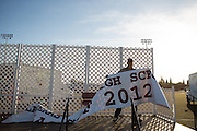 School faculty takes down the Cal Hills High School stage and backdrop after graduation on June 15, 2012.  Photo by Stan Olszewski/SOSKIphoto.