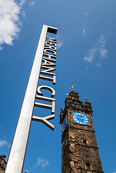 Merchant City sign and Tollbooth steeple or clocktower at Trongate in Glasgow, Scotland, united Kingdom