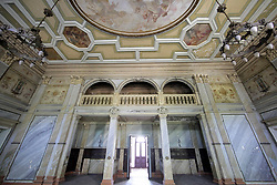 June 14, 2018 - Sharivka Urban-Type Settlement, Kharkiv Region, Ukraine - A gallery crowns an arched passage framed by two chandeliers inside the palace building of the 19th-20th century Sharivka Palace and Park Complex that served as a TB sanatorium during the Soviet era, Sharivka urban-type settlement, Bohodukhiv district, Kharkiv Region, northeastern Ukraine, June 14, 2018. Ukrinform. (Credit Image: © Vyacheslav Madiyevskyy/Ukrinform via ZUMA Wire)