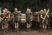 US Marine recruits fall into formation in a rain storm during bootcamp January 13, 2014 in Parris Island, SC.