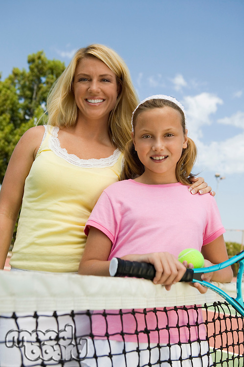 Mother and Daughter at Tennis Net