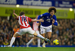 04122011, Goodison Park, Liverpool, ENG, Premier League, FC Everton vs Stoke City, 14 Spieltag, im Bild Everton's Marouane Fellaini in action against Stoke City during the football match of english Premier League, 14th round between FC Everton and Stoke City at Goodison Park, Liverpool, ENG on 2011/12/04. EXPA Pictures © 2011, PhotoCredit: EXPA/ Sportida/ David Rawcliff..***** ATTENTION - OUT OF ENG, GBR, UK *****