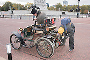 Broken down already, Passing Buckinham Palace and the Mall - Bonhams London to Brighton Veteran Car Run celebrates the 122nd anniversary of the original Emancipation Run of 1896 which celebrated the passing into law the Locomotives on the Highway Act so raising the speed limit for 'light automobiles' from 4mph to 14mph and abolishing the need for a man to walk in front of all vehicles waving a red flag. The Movember Foundation as our Official Charity Partner.
