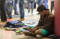 14.09.2015, Hauptbahnhof Salzburg, AUT, Fluechtlinge am Hauptbahnhof Salzburg auf ihrer Reise nach Deutschland, im Bild ein Flüchtling in der Tiefgarage blickt auf sein Handy // a Migrant wath on his Smartphone. Thousands of refugees fleeing violence and persecution in their own countries continue to make their way toward the EU, Main Train Station, Salzburg, Austria on 2015/09/14. EXPA Pictures © 2015, PhotoCredit: EXPA/ JFK