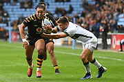 London Irish wing Ollie Hassell-Collins (11) comes in to tackle Wasps winger Marcus Watson (15) during the Gallagher Premiership Rugby match between Wasps and London Irish at the Ricoh Arena, Coventry, England on 20 October 2019.