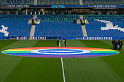 Rainbow Flag being displayed on the centre of the pitch ahead of the Premier League match between Brighton and Hove Albion and Wolverhampton Wanderers at the American Express Community Stadium, Brighton and Hove, England on 8 December 2019.