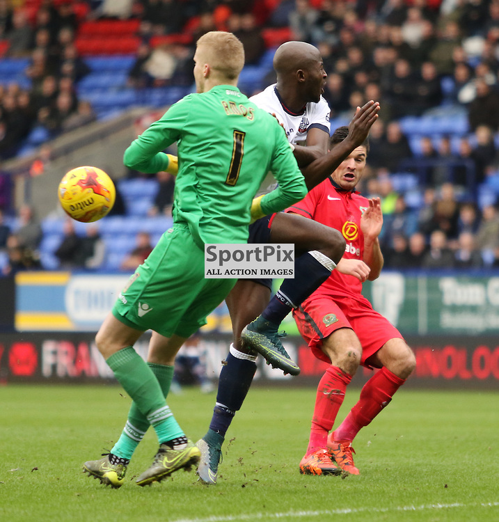 Mix up between Ben Amos and Prince-Desire Guano during the Bolton Wanderers FC v Blackburn Rovers FC Sky Bet Championship 28th December 2015 (c) EDDIE LINTON | SportPix.org.uk