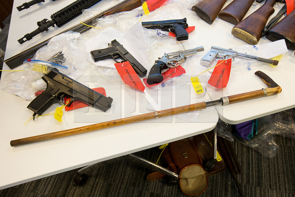 © Licensed to London News Pictures . 07/08/2014 . Manchester , UK . A shotgun that fires live ammunition , disguised as a walking stick . Greater Manchester Police displays some of the cache of firearms and ammunition they collected during a two week firearms amnesty in July , at the force's North Manchester headquarters , this morning (7th August 2014) . GMP reports collecting 225 firearms and over 3000 rounds of ammunition during the fortnight amnesty of which , they say, over 80 of the weapons were illegally owned . Amongst the haul were rifles, shotguns , handguns and air weapons as well as imitation and antique firearms . Photo credit : Joel Goodman/LNP
