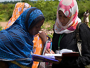 Saumu Ismai (pictured left), Treasurer of a womans group, discusses the crab project with Laize Abdallah, project co-ordinator Zanzibar Assocaition of Tourism Investors (ZATI). Laize and VSO volunteer Maurice Kwame Nyambok are helping to establish links with some of the many tourist hotels on Zanzibar, Tanzania. Currently Zanzibars hotels import 80 % of their produce. Opening up the market to the locals will help generate a vital income.