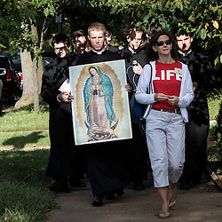Lisa Johnston | lisajohnston@archstl.org  | Twitter: @aeternusphoto Seminarians from Kenrick-Glennon Seminary led a rosary procession to Planned Parenthood.  About 450 pro-life supporters stood outside of Planned Parenthood in prayer after a Mass celebrated at the Cathedral Basilica.  A Rosary procession to Planned Parenthood on Forest Park Avenue followed.  Pro-lifer's were met by pink signs held by counter protesters supporting the abortion provider. Supporters of the abortion provided held signs behind a recently modified fence meant to obscure their view.