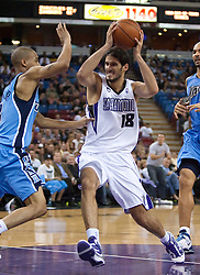 October 23, 2009; Sacramento, CA, USA;  Sacramento Kings forward Omri Casspi (18) drives in the lane past Utah Jazz guard Eric Maynor (3) during the fourth quarter at the ARCO Arena.  The Jazz won 95-85.