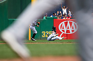 May 28, 2018 - Pittsburgh, PA, U.S. - PITTSBURGH, PA - MAY 28:  Pittsburgh Pirates left fielder Corey Dickerson (12) slides under a fly ball for the catch during an MLB game between the Pittsburgh Pirates and Chicago Cubs on May 28, 2018 at PNC Park in Pittsburgh, PA. (Photo by Shelley Lipton/Icon Sportswire) (Credit Image: © Shelley Lipton/Icon SMI via ZUMA Press)