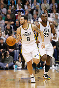 Jazz point guard Deron Williams (8) and center Al Jefferson (25) head down the court during an NBA basketball game in Salt Lake City, Wednesday Jan. 26, 2011. (AP Photo/Colin E Braley)