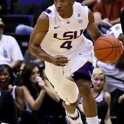December 15, 2011; Baton Rouge, LA; LSU Tigers guard Chris Bass (4) drives down the court against the UC Irvine Anteaters during the first half of a game at the Pete Maravich Assembly Center.  Mandatory Credit: Derick E. Hingle-US PRESSWIRE