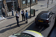 Met Police officers question a car driver in the borough of Southwark, on 19th April, in the City of London, England.