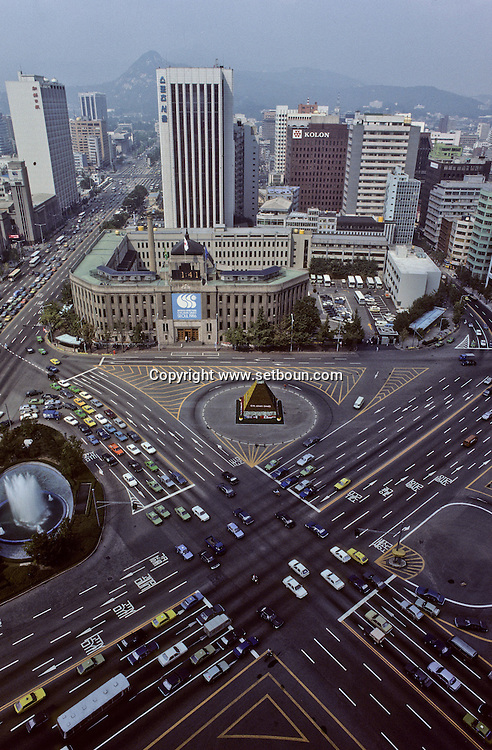 Seoul, South Korea --- Traffic crosses through City Hall Plaza in front of Seoul's City Hall.