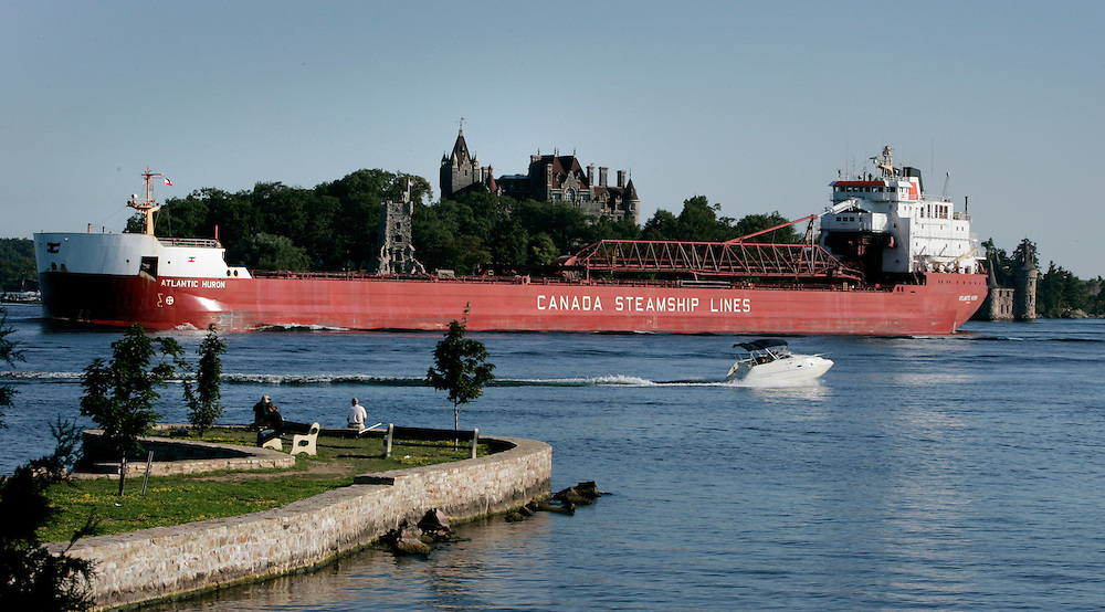 St. Lawrence, nws, lynn, 16.-The Atlantic Huron sails past the Boldt Castle through the 1000 Islands portion of the St. Lawrence River on its way upbound toward Lake Ontario Sunday August 6, 2005.  Photographed from Alexandria Bay New York ships really thread a needle through this area.