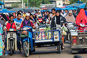 25 OCTOBER 2012 - PATTANI, PATTANI, THAILAND: People drive into the market in Pattani, Thailand.      PHOTO BY JACK KURTZ