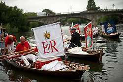 © Licensed to London News Pictures. 20/07/2015. Swan Upping takes place on the River Thames near Windsor, Berkshire, UK. The annual event dates from medieval times, when The Crown claimed ownership of all mute swans which were considered an important food source for banquets and feasts. Today, the cygnets are weighed and measured to obtain estimates of growth rates and the birds are examined for any sign of injury, commonly caused by fishing hook and line. The cygnets are ringed with individual identification numbers by The Queen's Swan Warden, whose role is scientific and non-ceremonial. The Queen's Swan Marker produces an annual report after Swan Upping detailing the number of swans, broods and cygnets counted during the week. Photo credit: Ben Cawthra/LNP
