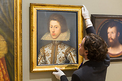 London, July 3rd 2017. A Bonhams gallery assistant hangs William Larkin's Portrait of Thomas Pope, estimated to fetch between £40-60,000 in their forthcoming Old Master Paintings sale