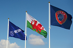 NEWPORT, WALES - Saturday, April 20, 2013: The UEFA flag flies alongside the Welsh flag at the opening of the FAW National Development Centre in Newport. (Pic by David Rawcliffe/Propaganda)
