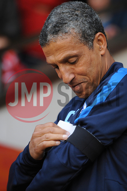 Brighton & Hove Albion Manager Chris Hughton puts on a black armband to show his respect for the Shoreham Airshow tragedy where a member of the Brighton ground staff died  - Mandatory byline: Dougie Allward/JMP - 07966386802 - 25/08/2015 - FOOTBALL - Bescot Stadium -Walsall,England - Walsall v Brighton - Capital One Cup - Second Round