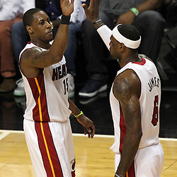 Jun 21, 2012; Miami, FL, USA; Miami Heat point guard Mario Chalmers (15) high fives small forward LeBron James (6) during the first quarter in game five in the 2012 NBA Finals against the Oklahoma City Thunder at the American Airlines Arena. Mandatory Credit: Derick E. Hingle-US PRESSWIRE