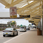 The passenger unloading zone at Orlando International Airport remains functional but mostly empty to air passengers on Friday, April 17, 2020 in Orlando, Florida. (Alex Menendez via AP)