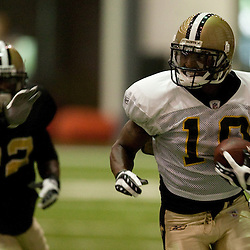 08 August 2009: Receiver Skyler Green (10) runs away from cornerback Tracy Porter (22) during the New Orleans Saints annual training camp Black and Gold scrimmage held at the team's indoor practice facility in Metairie, Louisiana.