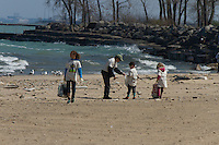 Hyde Park celebrated Earth Day this past Saturday with environmentally friendly events around the neighborhood.<br /> <br /> 8148 &ndash; Camilla Smith-Donald, Jackson Park Advisory Council president, Loise Mcurry, Elder Chapman and Helena Smith-Donald pick up garbage at 57th Street Beach.<br /> <br /> Please 'Like' &quot;Spencer Bibbs Photography&quot; on Facebook.<br /> <br /> All rights to this photo are owned by Spencer Bibbs of Spencer Bibbs Photography and may only be used in any way shape or form, whole or in part with written permission by the owner of the photo, Spencer Bibbs.<br /> <br /> For all of your photography needs, please contact Spencer Bibbs at 773-895-4744. I can also be reached in the following ways:<br /> <br /> Website &ndash; www.spbdigitalconcepts.photoshelter.com<br /> <br /> Text - Text &ldquo;Spencer Bibbs&rdquo; to 72727<br /> <br /> Email &ndash; spencerbibbsphotography@yahoo.com