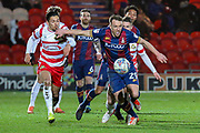 Bradford City defender Tony McMahon wins the ball during the EFL Sky Bet League 1 match between Doncaster Rovers and Bradford City at the Keepmoat Stadium, Doncaster, England on 19 March 2018. Picture by Aaron  Lupton.