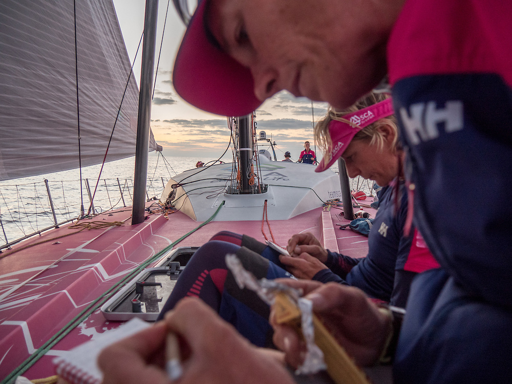 January 9, 2015. Leg 3 onboard Team SCA. Carolijn Brouwer and Abby Ehler take notes on the bow.