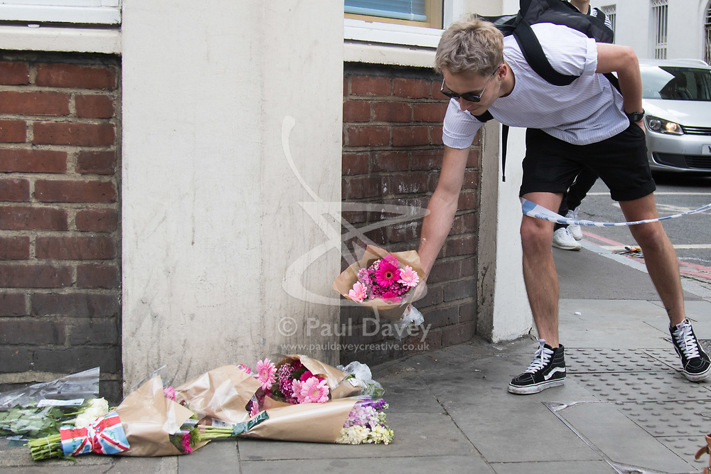 London, June 4th 2017. A man places flowers at Borough High Street during a massive policing operation in the aftermath of the terror attack on London Bridge and Borough Market on the night of June 3rd which left seven people dead and dozens injured