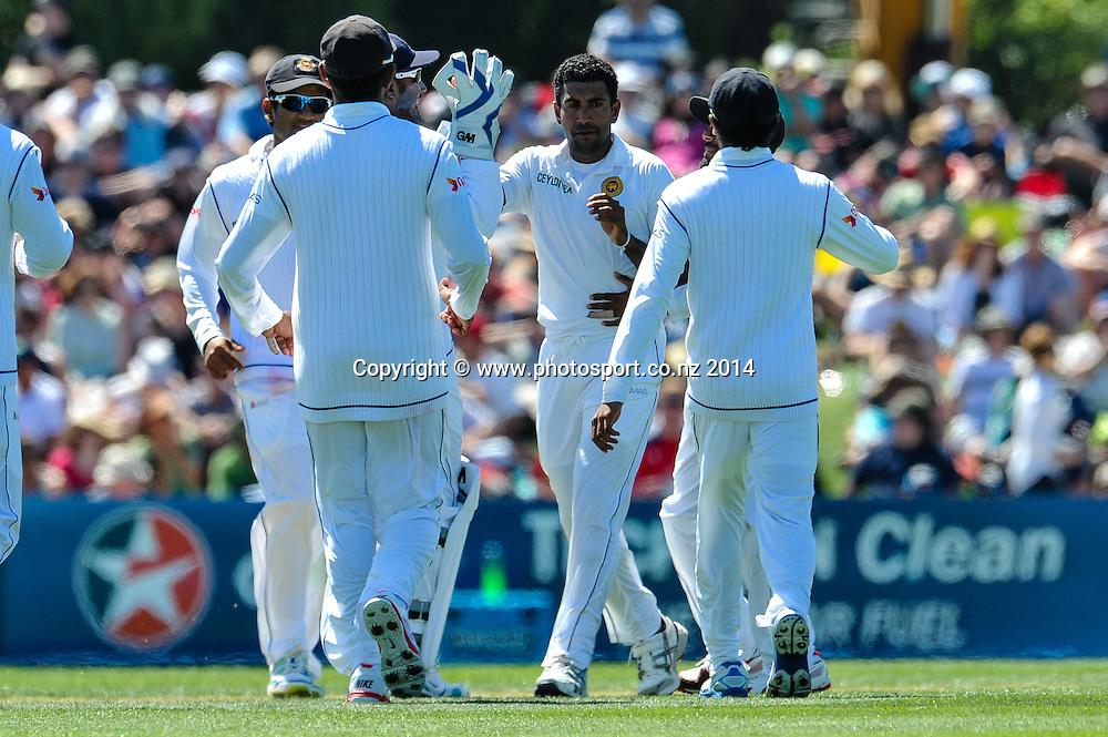 Sri Lanka celebrates hte wicket of Kane Williamson, bowled by Dhammika Prasad of Sri Lanka in the 1st day of the cricket test match, NZ v Sri Lanka, Hagley Oval, 26 December 2014. Photo:John Davidson/www.photosport.co.nz