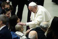 Jan 07th 2015 Vatican City, Pope Francis attends his weekly general audience. in the picture the pope greets a child