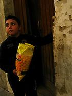 Boy outside his door, Noto Sicily, Italy, 2012.