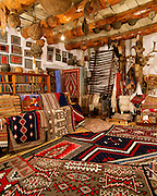 0108-1006B ~ George H. H. Huey ~ The Rug Room, with modern Navajo Indian weavings. Founded by John Lorenzo Hubbell in 1876. Still an active trading post today. Hubbell Trading Post National Historic Site, Arizona, Navajo rugs,