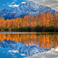 Pioneer Peak reflects in Echo lake near Palmer, Alaska during fall. Photo was captured using High Dynamic Range(HDR).