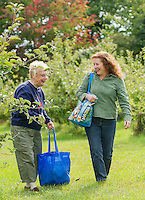 Thelma Rich and her daughter Robin Kirk enjoy the afternoon picking a variety of apples at Smith Orchard in Belmont Thursday afternoon.  (Karen Bobotas/for the Laconia Daily Sun)