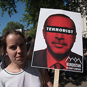 Kurdistan Solidarity Campaign host protests against the Turkey President visiting Downing street invited by Therese May chanting Erdogan is a terrorist with heavy police of guards on 15 May 2018, London, UK.