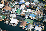 Tightly clustered houseboats on Lake Union have been bought up and rebuilt.  Today, this neighborhood has a unique character that adds to the identity of the region.  The real estate values of the houseboats are high, despite their small size and tight quarters.