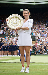 LONDON, ENGLAND - Saturday, July 13, 2019: Simona Halep (ROU) celebrates with the Venus Rosewater Dish trophy after winning the Ladies' Singles final match on Day Twelve of The Championships Wimbledon 2019 at the All England Lawn Tennis and Croquet Club. Halep won 6-2, 6-2. (Pic by Kirsten Holst/Propaganda)