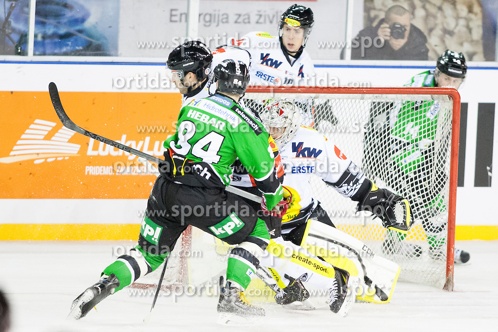 24.12.2014, Republic Square, Ljubljana, SLO, EBEL, HDD Telemach Olimpija Ljubljana vs EC Dornbirn, 30. Runde, in picture Andrej Hebar (HDD Telemach Olimpija, #84) and Nathan Lawson (EC Dornbirn, #52) during the Erste Bank Icehockey League 30. Round between HDD Telemach Olimpija Ljubljana and EC Dornbirn on Republic Square, Ljubljana, Slovenia on 2014/12/16. Photo by Urban Urbanc / Sportida