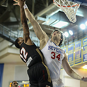 Erie BayHawks Lewis Jackson (12) drives towards the basket as Delaware 87ers Center Kyrylo Fesenko (34) defends in the second half of a NBA D-league regular season basketball game between the Delaware 87ers (76ers) and the Erie BayHawks (Knicks) Tuesday, Feb. 11, 2014 at The Bob Carpenter Sports Convocation Center, Newark, DE