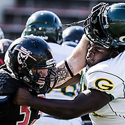 Justin Lantz (33) of Santa Ana College battles Devonte Rodgers (36) of Grossmont College. Grossmont defeated Santa Ana College 30-23 at Santa Ana Stadium.